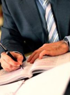 Midland Lawyer, Man Writing In Book Picture - Poznak Dyer Kanar Garchow, PLC